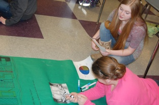 Angel Peirce and Lexy Underhill work on their project for about tobacco.