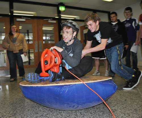 Senior Britton Mahler takes a go at hover crafting.