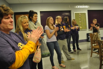 Friends and teammates of Sears congratulate her on her accomplishment.