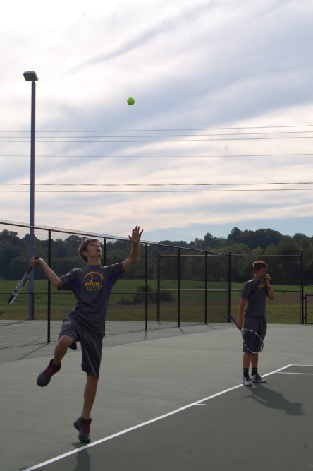 Juniors Trey Yother and Michel Fullington warming up before the match.