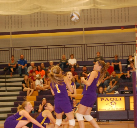 The seventh grade Paoli Rams Volleyball team work together to defeat the opposing team.