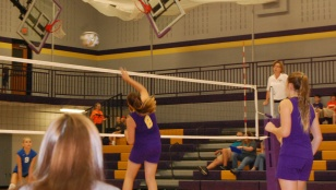 Seventh grader Jackie Rice spikes the ball over the net.