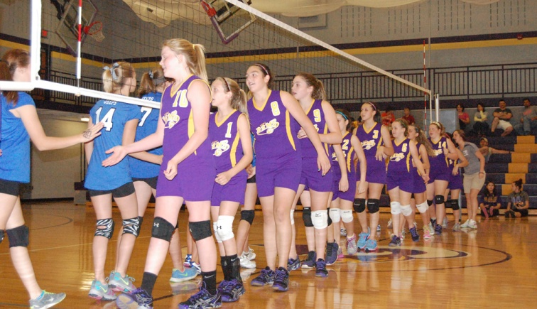 The seventh grade team shakes hands with the opposing group after a victory.