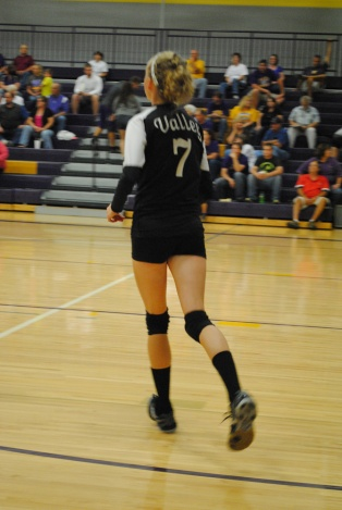A Springs Valley player runs onto the court.