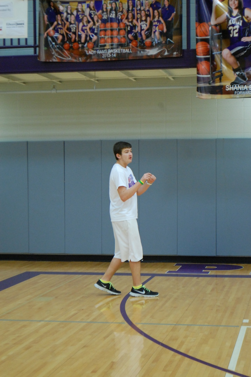 Eighth grader Braydon Kloss moves down the floor to get the basketball from his teammate at junior high recess on Wednesday.