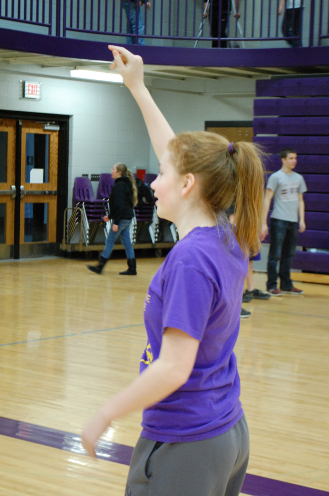 Eighth grader Harli Wilder tries to get her teammate's attention to get the ball during junior high lunch recess.