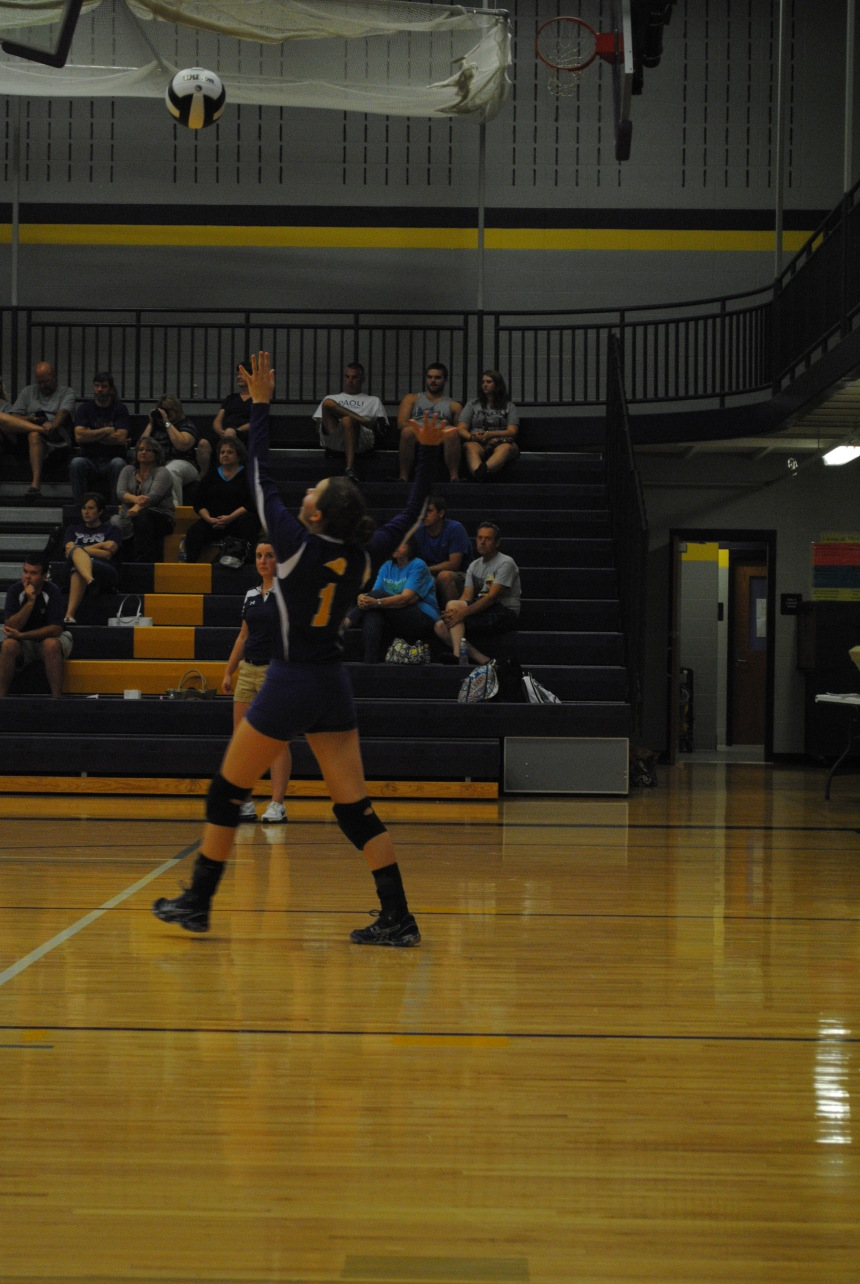 Freshman Ashley Archer goes up for a serve in the JV volleyball game against Salem.