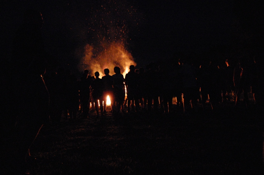 Students watching the bonfire and enjoying themselves.