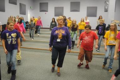 1. Mrs. Debra Stroud teaches her Junior High Choir how to box step.