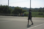 Eighth grader Ashton Minton plays singles against Bedford Middle.