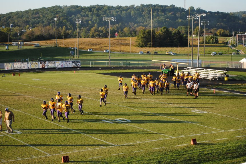 Junior high football boys run out ready to play West Washington.