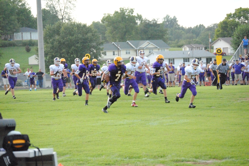 Freshman Tyler Smith runs the football in for a touchdown against Scottsburg.