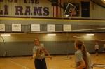 2.)Eighth grader Jackie Rice hits the birdie.
