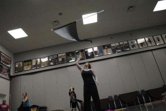 Senior Trisha Ratliff demonstrates a parallel toss during guard practice.
