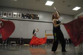 Senior Trisha Ratliff and freshman Haley Roach rehearse routine for color guard show.
