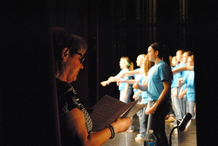 Director Debra Stroud sings along with the junior high choir.