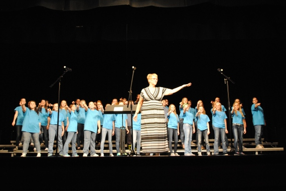 Director Debra Stroud doing a final bow with the junior high choir