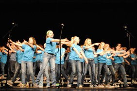 The Treble Makers dance to a song during the choir concert.