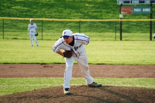 Senior Zane Jones gets in position to fire in a fast pitch during a Varsity baseball game.
