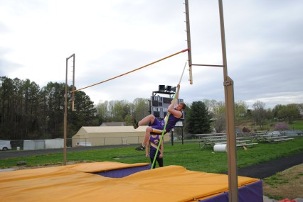 Junior Michael Whidden practices pole vaulting.