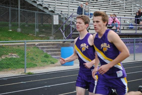 Freshman Chaz Becht and senior Chris Lambert run a mile.