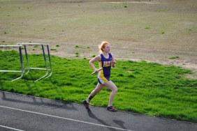 Senior Kylene Baker runs during the 4 x 4 relay.