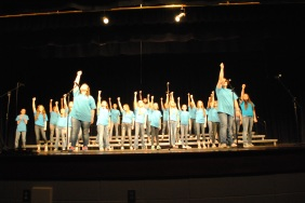 """With two soloists, Rebeka Reeves (left) and Megan Poe (right), The Treble Makers Sing """"Brave""""."""