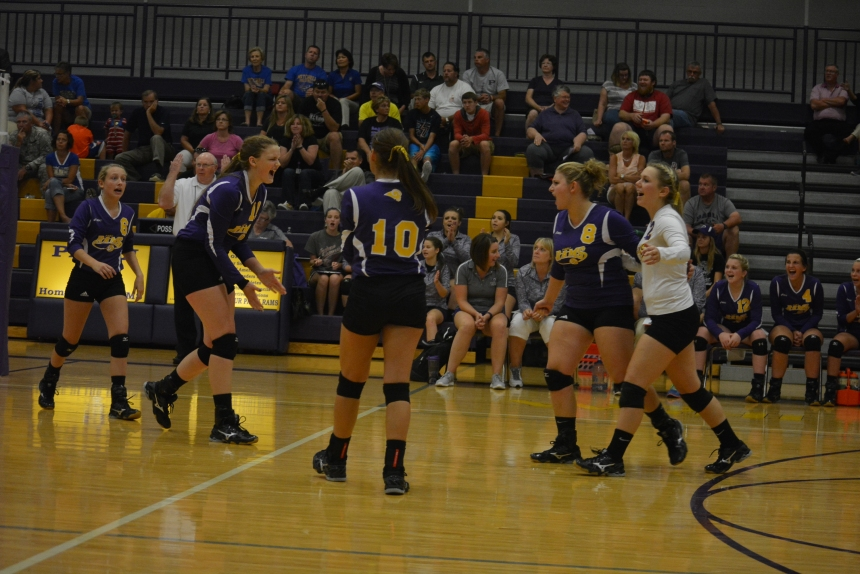 Madison Street, Anna Hutcheson, Claire Cornwell, Olivia Becht and Amber Smith celebrating after a point at the game last night against Mitchell.