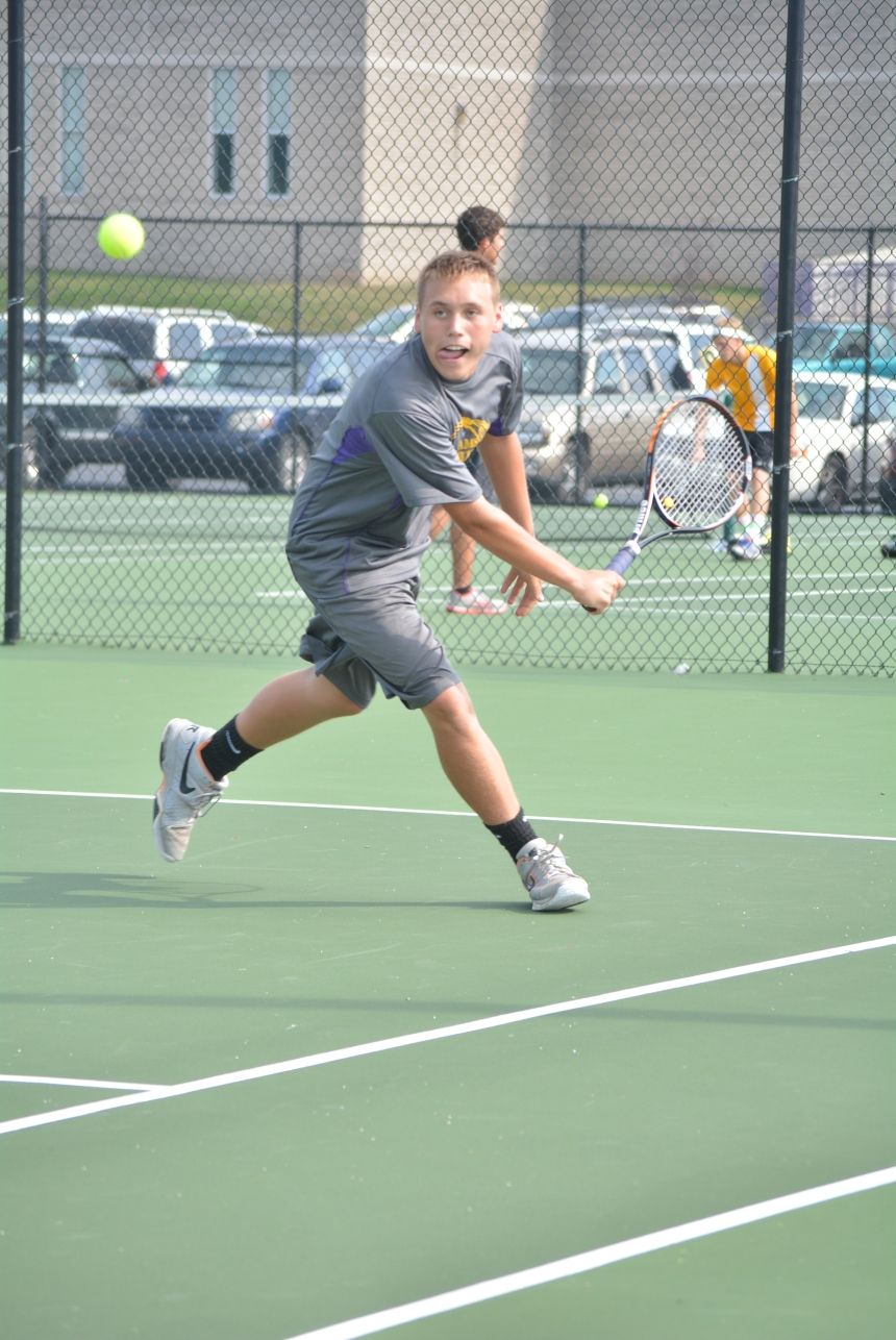 Sophomore, Kyle Marshall swings to return the ball at the tennis match last night against Salem.