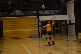 Camille Warren throws her ball up at their home game.