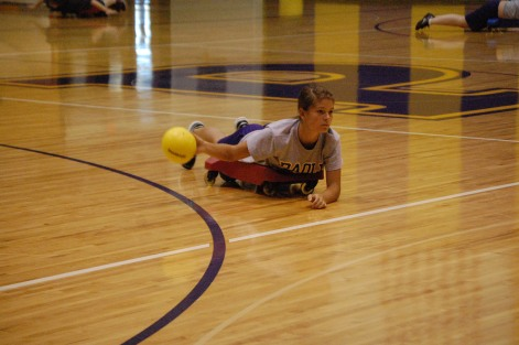 Freshman Rachel Umpleby goes to throw the ball during a game in class.