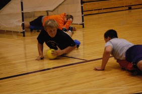 Sophomore Matt Webb blocks the ball during a game in gym class.