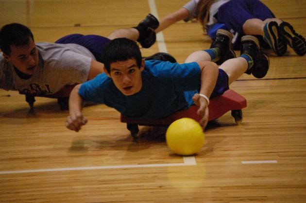 Freshman Cameron Fields rolls the ball to the net.
