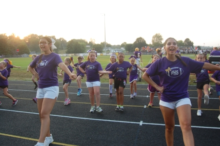 Junior June Hobson and Sophomore Marixa Oceguera cheer last Friday night during the football game.