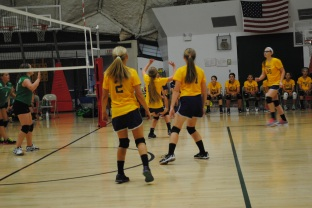 Eighth grader EB Kerby sets the ball to Kinley Block.