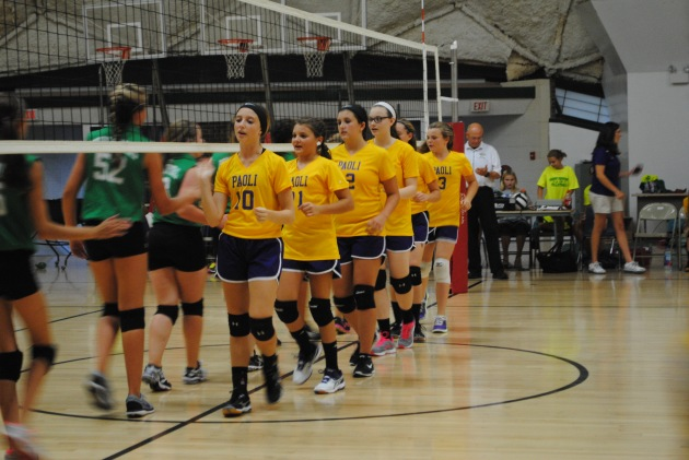 Eighth grade girls clap hands before the game.