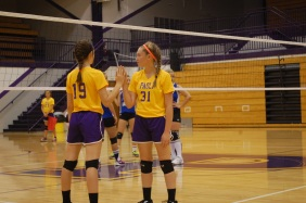 Eighth grade volleyball players Harley Bush and Kinley Block switch out during their home game.