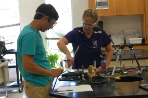 Mrs. Higgins and senior Mason Deaton test different elements burning. Deaton is the only student that attends this chemistry class, ¨We were showing how different elements burn in different colors,¨ said Mrs. Higgins.