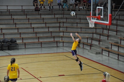 Eighth grader Kinley Block jumps to serve the ball during her game against Orleans. This is Block's fourth year playing volleyball. ¨My favorite part about volleyball is getting to relieve all the stress I had throughout the day in a ball and my hands, arms, and legs,¨ said Block.