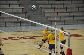 Eighth grader Lexie K. Stroud passes the ball over the net to her opponents. Stroud plays the number two hitter position. ¨My favorite part about volleyball is spiking because it makes you feel accomplished,¨ said Stroud.