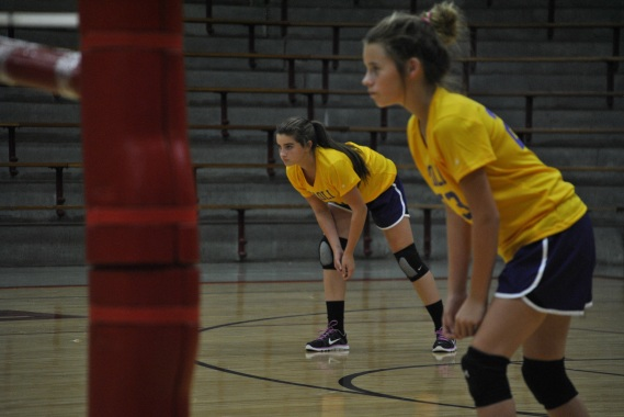 Seventh grader Alyssa Warren is in her ¨down and ready¨ position awaiting a serve from Orleans.