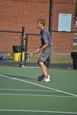 Senior Kyle Street gets ready for the ball to come to him during a home tennis match.