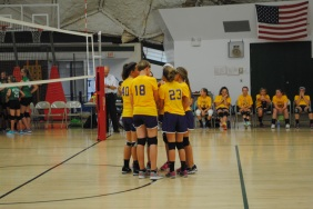 Seventh grade girls making plans for the third set.