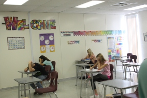 Students take a test in study hall.