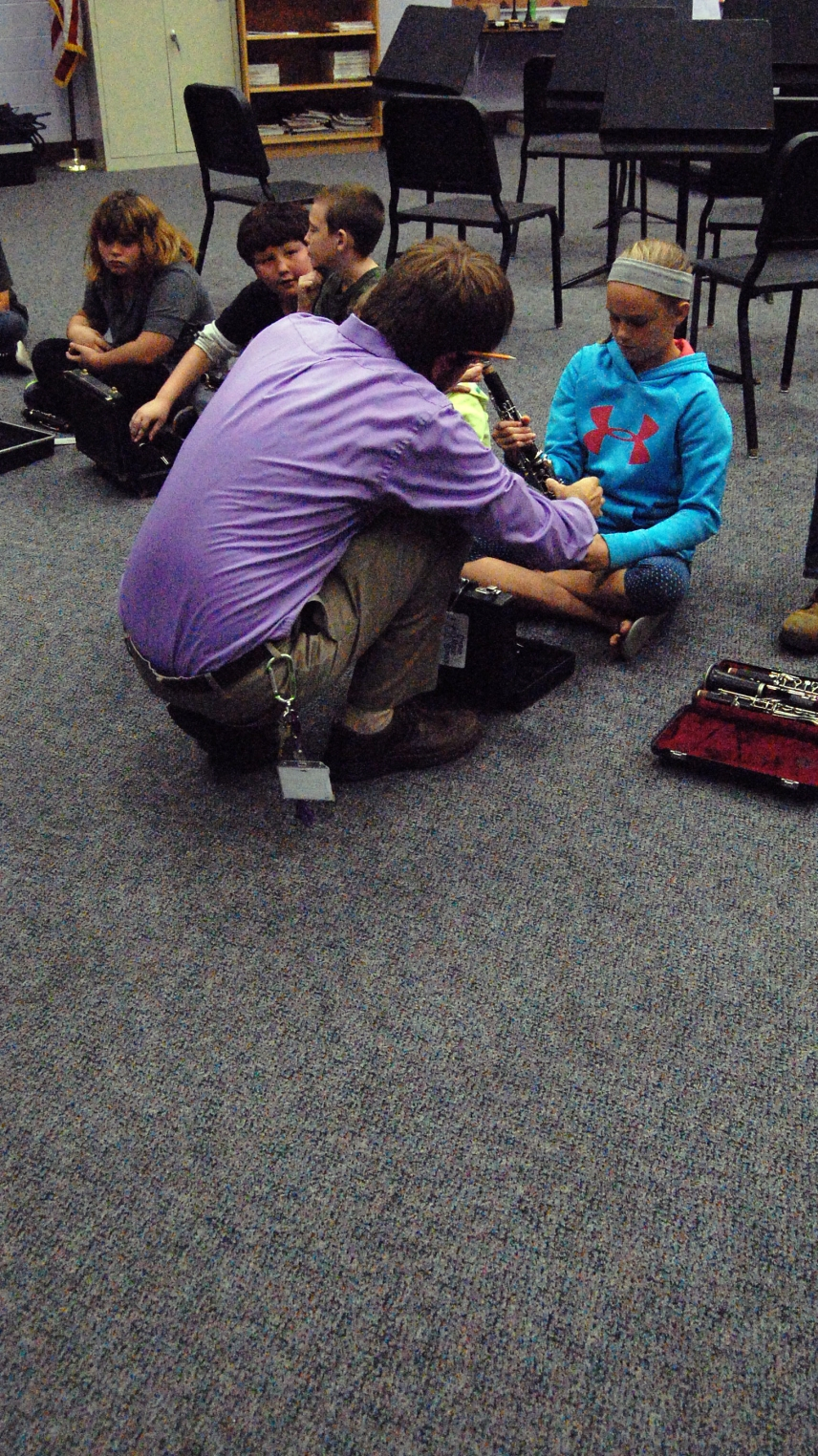Band teacher Mr.Werne helps a sixth grade student with her clarinet.