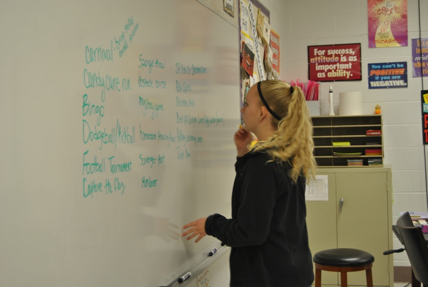 Jr High student council president Avery Owens writes down ideas for the Christmas celebration.
