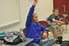 Jr High student council member Maddy McDonald raises her hand to give an idea for the Christmas celebration.