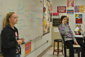 President Avery Owens and Vice President Harley Bush discuss the Jr High Christmas celebration.