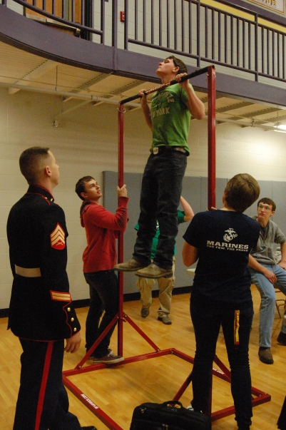 Sophomore Lee Allbright does pull ups during the 2015 college fair.