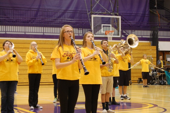 Senior Alex Baker stands still while playing Friday at the pep session.